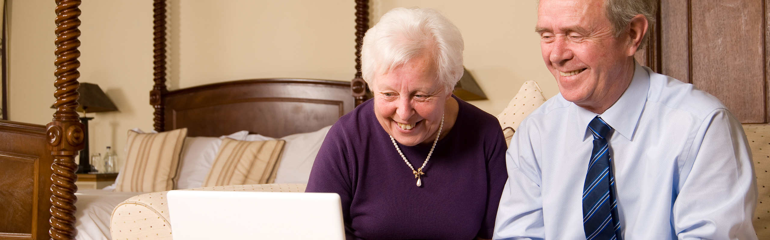 elderly couple with a laptop